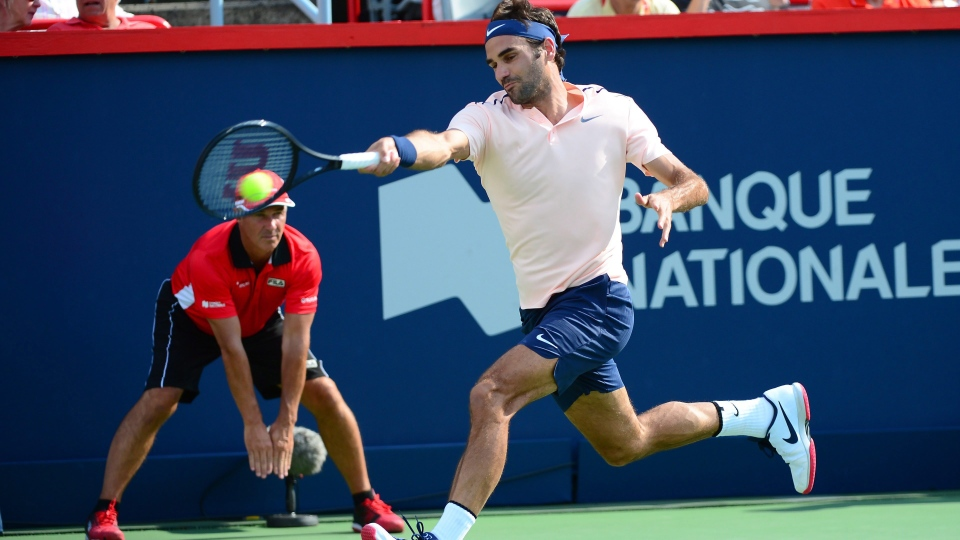 Roger Federer of Switzerland hits a fore to Alexander Zverev of Germany during the final of the Rogers Cup tennis tournament Sunday, August 13, 2017 in Montreal. THE CANADIAN PRESS/Paul Chiasson