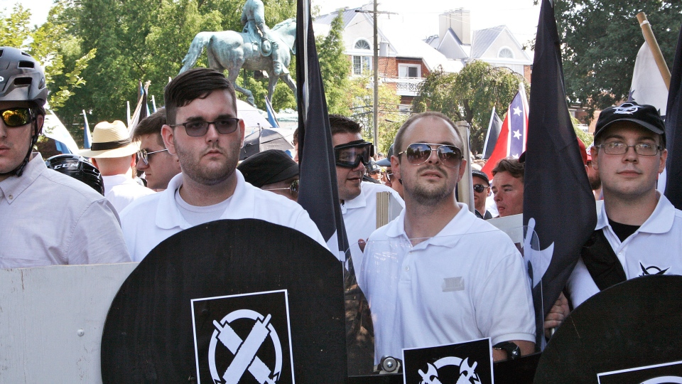 James Alex Fields Jr., second from left, holds a black shield in Charlottesville, Va., where a white supremacist rally took place on Saturday, Aug. 12, 2017. (AP / Alan Goffinski)