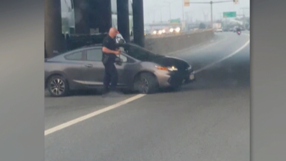 Cellphone video captured by a witness shows police slashing the tires of a vehicle driving the wrong way down Highway 1 on Aug.10, 2017. (Jay Thandi)