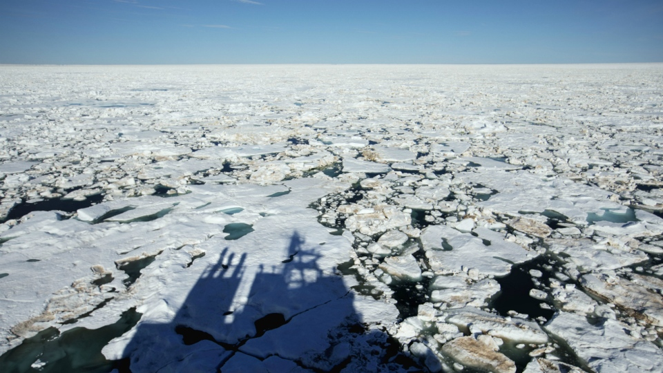The Finnish icebreaker MSV Nordica casts a shadow on the ice while traversing the Northwest Passage through the Victoria Strait in the Canadian Arctic Archipelago on Friday, July 21, 2017. (AP / David Goldman)