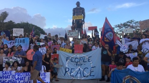 About a hundred people gather at Chief Kepuha Park in Hagatna, Guam for a rally for peace Monday, Aug. 14, 2017. The U.S. territory has been the subject of threats from North Korea in its escalating war of words with the U.S. President Donald Trump's administration. (AP Photo / Tassanee Vejpongsa)