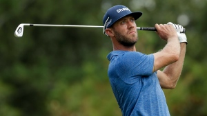 Graham DeLaet watches his tee shot on the sixth hole during the first round of the PGA Championship golf tournament at the Quail Hollow Club Thursday, Aug. 10, 2017, in Charlotte, N.C. (AP Photo/Chuck Burton)