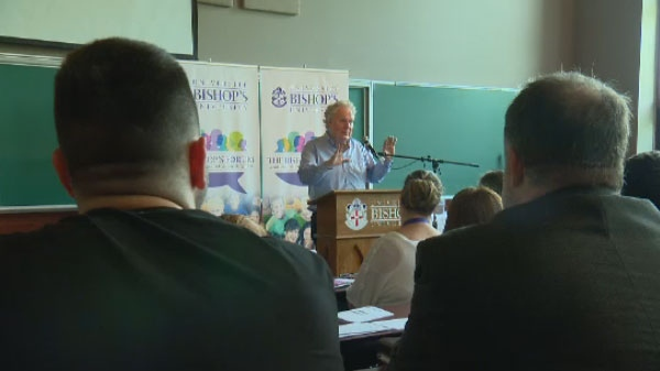 Former Quebec premier Jean Charest addresses university students at the inaugural Bishop's Forum.