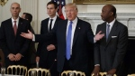 U.S. President Donald Trump in the Roosevelt Room of the White House, on Feb. 23, 2017. From left are, Archer Daniels Midland CEO Juan Luciano, White House Senior Adviser Jared Kushner, Trump, and Merck CEO Kenneth Frazier. (Evan Vucci / AP)