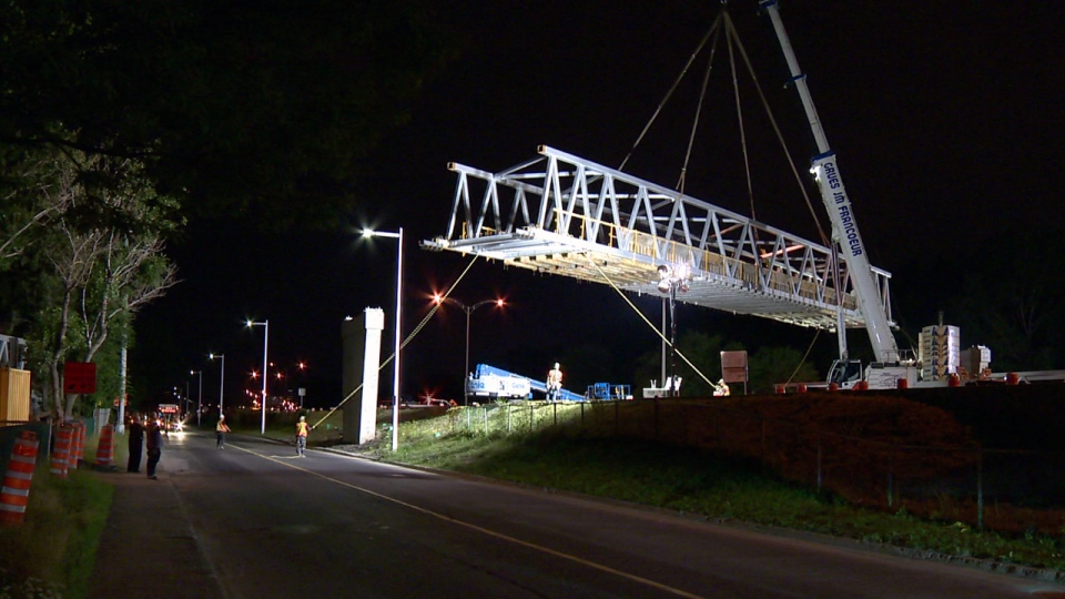 Construction crews installed a new pedestrian walkway overnight in Longueuil (CTV Montreal/Cosmo Santamaria)