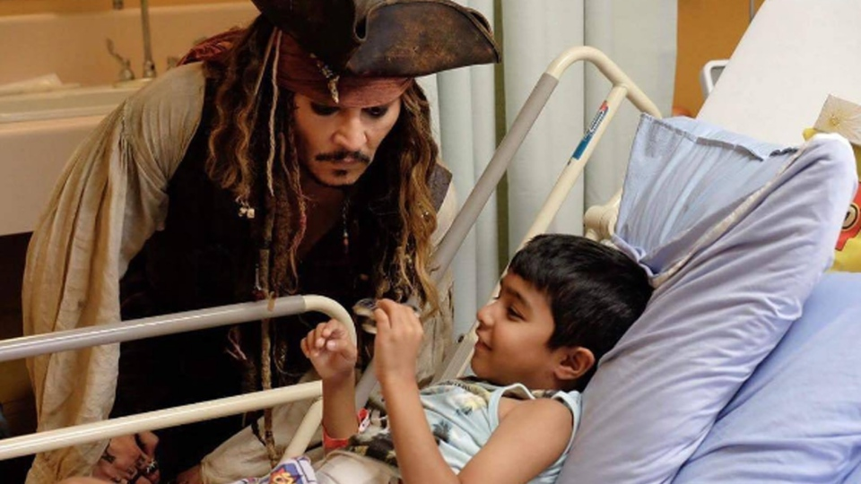 Johnny Depp visits a young patient at the B.C. Children's Hospital as his character Captain Jack Sparrow, from the 'Pirates of the Caribbean' films, on Aug. 14, 2017. (Instagram)