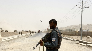 An Afghan policeman stands guard in Kandahar, Afghanistan, on Aug. 2, 2017. (AP)