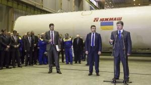 Ukrainian President Petro Poroshenko, right, speaks as he visits the Yuzhmash aerospace enterprise (Southern Engineering plant) in Dnipro, Ukraine, on Oct. 21, 2014. (Mikhail Palinchak / Pool Photo via AP)