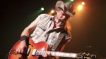 Ted Nugent performing in Baltimore, on Aug. 16, 2013. (Photo by Owen Sweeney / Invision / AP)