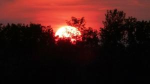 Smoky sunset over Gimli. Photo by Terri and Steve Rawson.
