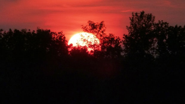Smoky sunset over Gimli. Photo by Terri and Steve Rawson.