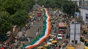 Indians carry a huge Indian national flag as they celebrate Independence Day in Ahmadabad, India, Tuesday, Aug. 15, 2017. India commemorates its Independence in 1947 from British colonial rule on Aug. 15. (Ajit Solanki / AP)