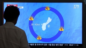 A man watches a TV screen showing a local news program reporting on North Korea's threats to strike Guam with ballistic missiles, at the Seoul Train Station in Seoul, South Korea on Aug. 10, 2017. (Ahn Young-Joon/AP)