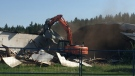 Crews knock down the 60-year-old riding arena at the Whitemud Equine Centre on Tuesday, August 15, 2017.