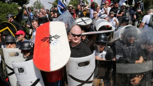 White nationalist demonstrators use shields as they guard the entrance to Lee Park in Charlottesville, Va., Saturday, Aug. 12, 2017. (Steve Helber/AP Photo)
