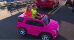New ride-on toy car given to girl