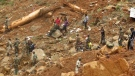 """Security forces search for bodies from the scene of heavy flooding and mudslides in Regent, just outside of Sierra Leone's capital Freetown, Tuesday, Aug. 15 , 2017. Survivors of deadly mudslides in Sierra Leone's capital are vividly describing the disaster as President Ernest Bai Koroma says the nation is in a """"state of grief."""" (AP Photo/ Manika Kamara)"""