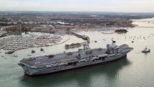 Britain's new flagship HMS Queen Elizabeth arrives in Portsmouth, Britain, Wednesday Aug. 16, 2017. (Gareth Fuller / PA via AP)