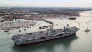 Britain's new flagship HMS Queen Elizabeth arrives in Portsmouth, Britain, Wednesday Aug. 16, 2017. (Gareth Fuller / PA via AP)
