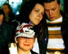 Victoria Stafford's mother Tara McDonald hugs her son Daryn, and partner James Gorris at a community candlelight vigil on the fourth day of the search for missing eight-year-old in Woodstock, Ontario, Sunday, April 12, 2009. (Dave Chidley / THE CANADIAN PRESS)
