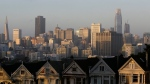 """In this photo taken Tuesday, July 11, 2017, the Salesforce Tower, at right, is seen along the skyline beyond the """"Painted Ladies"""" Victorian homes in San Francisco. (AP / Eric Risberg)"""