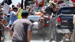 Marcus Martin is seen in the air as a vehicle drives into protesters demonstrating against a white nationalist rally in Charlottesville, Va., on Aug. 12, 2017. (The Daily Progress via AP / Ryan M. Kelly)
