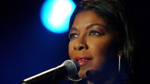 In a Sunday, July 6, 2003 file photo, singer Natalie Cole performs on Stravinsky stage, during the 37th Montreux Jazz Festival, in Montreux, Switzerland. (AP Photo/ Keystone, Martial Trezzini, File)