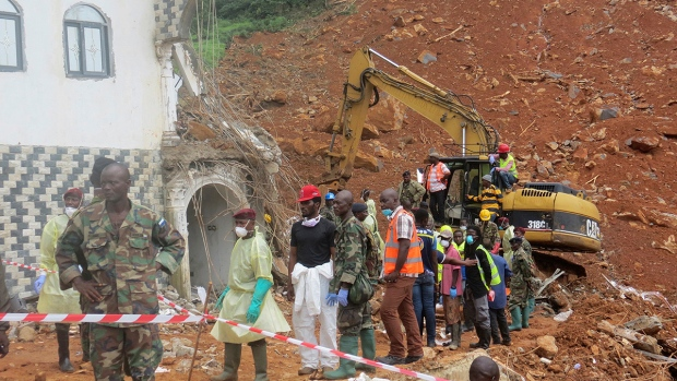Rescue workers search for bodies from the scene of heavy flooding and mudslides in Regent, just outside of Sierra Leone's capital Freetown, Tuesday, Aug. 15, 2017. (AP / Manika Kamara)