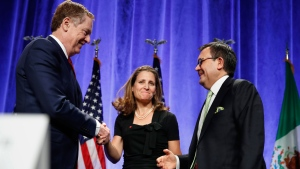 U.S. Trade Representative Robert Lighthizer, left, shakes hands with Canadian Foreign Affairs Minister Chrystia Freeland, accompanied by Mexico's Secretary of Economy Ildefonso Guajardo Villarreal, after they spoke at a news conference, Wednesday, Aug. 16, 2017, at the start of NAFTA renegotiations in Washington. (AP Photo/Jacquelyn Martin)