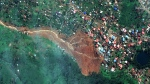 Satellite image of the mudslide, centre, in Freetown, Sierra Leone. (DigitalGlobe via AP)