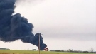 An oil tanker burns in a field near Stoughton after a lightning strike on Aug. 15, 2017 (Twitter: Cheryl Lake)