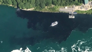 Provided by Rainbow Air INC., black-colored wastewater treatment discharge is released into water below Niagara Falls, in Niagara Falls, N.Y.  on July 29, 2017. (Patrick J. Proctor/Rainbow Air INC. via AP)