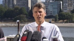 Vancouver Mayor Gregor Robertson speaks outside City Hall this weekend. Aug. 15, 2017.
