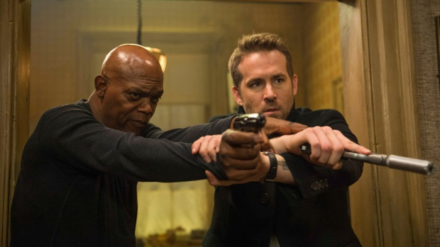 """This image released by Lionsgate shows Samuel L. Jackson, left, and Ryan Reynolds in """"The Hitman's Bodyguard."""" (Jack English/Lionsgate via AP)"""