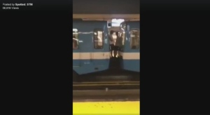 Two people stand between metro cars as it pulls out of the station (image: Spotted: STM)