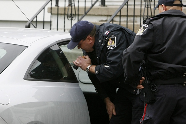 Oxford Community Police search a car as they continue the search for missing eight-year-old Victoria Stafford in Woodstock, Ont., on Monday, April 13, 2009. (Dave Chidley / THE CANADIAN PRESS)