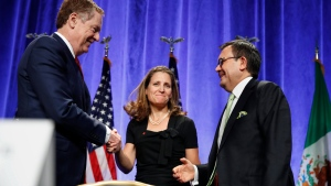 U.S. Trade Representative Robert Lighthizer, left, shakes hands with Canadian Foreign Affairs Minister Chrystia Freeland, accompanied by Mexico's Secretary of Economy Ildefonso Guajardo Villarreal, after they spoke at a news conference, Wednesday, Aug. 16, 2017, at the start of NAFTA renegotiations in Washington. (AP / Jacquelyn Martin)