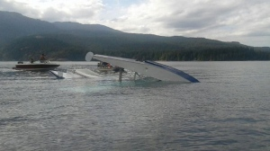 A pilot appears to be uninjured after a float plane flipped in a hard landing on Comox Lake Wednesday, Aug. 16, 2017. (Courtesy Rubina MacDonald)