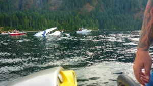 Boaters rushed to assist a pilot after a float plane flipped during a hard landing in Comox Lake Wednesday, Aug. 16, 2017. (Courtesy Gregg Bedford/Rubina MacDonald)