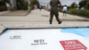 A South Korean soldier walks by the map of North Korea at the Imjingak Pavilion in Paju, South Korea on Wednesday, Aug. 16, 2017. (AP / Lee Jin-man)