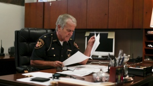 Lucas County Sheriff John Tharp looks through papers in his office in Toledo, Ohio on Aug. 9, 2017. (AP / Dake Kang)
