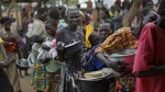 South Sudanese refugees queue to receive a lunch of maize mash and beans, at the Imvepi reception centre, where newly arrived refugees are processed before being allocated plots of land in nearby Bidi Bidi refugee settlement, in northern Uganda on Tuesday, June 6, 2017. (AP / Ben Curtis)