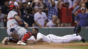 Boston Red Sox's Jackie Bradley Jr. slides home as the ball gets away from St. Louis Cardinals catcher Yadier Molina while scoring on the game-winning, two-run double by Mookie Betts during the ninth inning of a baseball game in Boston on Wednesday, Aug. 16, 2017. (AP / Charles Krupa)