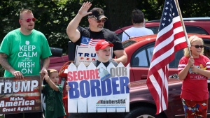 Trump supporters of all ages wave and shout slogans to drivers in Wilkes Barre, Pa, during a informational rally held on Saturday, Aug. 13, 2017. (Dave Scherbenco / The Citizens' Voice via AP)