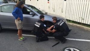A pair of police officers helped cooking show host Alexandra Diaz with a flat tire (CTV Montreal/Wayne Toplosky)