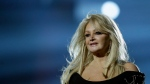 "In this May 17, 2013, file photo, Bonnie Tyler performs her song ""Believe in Me"" during a rehearsal for the final of the Eurovision Song Contest at the Malmo Arena in Malmo, Sweden.  (AP Photo / Alastair Grant, File)"