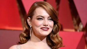 FILE - In this Feb. 26, 2017 file photo, actress Emma Stone arrives at the Oscars in Los Angeles. Stone says that male co-stars have taken pay cuts to ensure she received equal pay on films. Speaking to tennis great Billie Jean King in an interview published Thursday, July 6, in Out Magazine, Stone said the gesture to match has impacted what she's able to ask for in the future. (Photo by Richard Shotwell/Invision / AP, File)