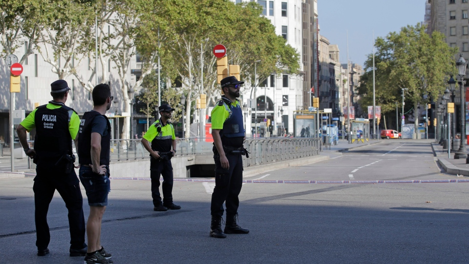 Police officers cordon off a street in Barcelona, Spain, Thursday, Aug. 17, 2017. (AP Photo/Manu Fernandez)