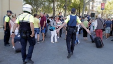 Police officers tell members of the public to leave the scene in a street in Barcelona, Spain, Thursday, Aug. 17, 2017. Police in the northern Spanish city of Barcelona say a white van has jumped the sidewalk in the city's historic Las Ramblas district, injuring several people. (AP Photo / Manu Fernandez)