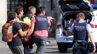 An injured person is carried in Barcelona, Spain, Thursday, Aug. 17, 2017, after a white van jumped the sidewalk in the historic Las Ramblas district, crashing into a summer crowd of residents and tourists and injuring several people, police said. (AP / Oriol Duran)